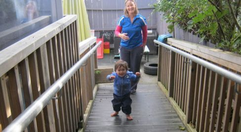 Staff and young boy at child care centre in Auckland