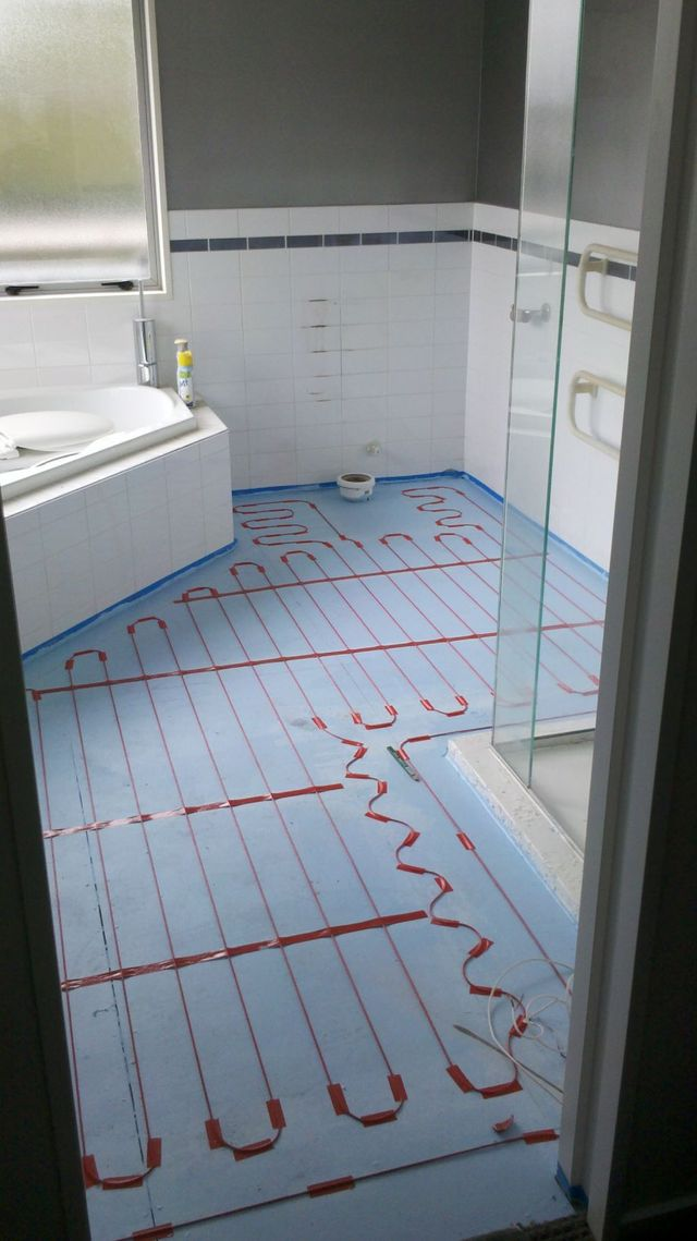 Heating installation under floor tiles in Canterbury
