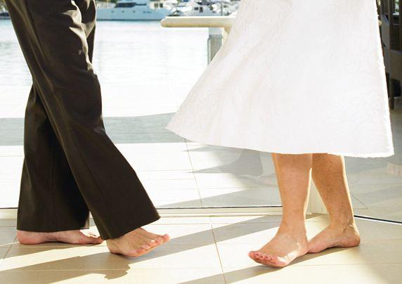 Couple in bare feet on tiles