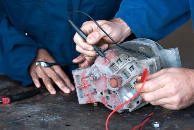 Mechanics fixing car parts in Oamaru