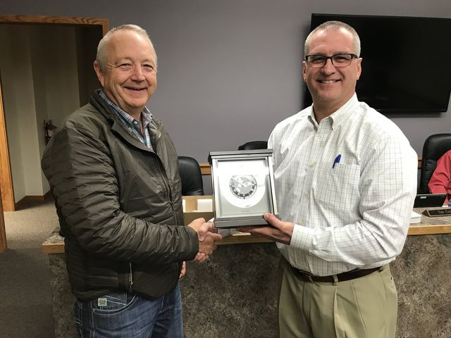 Luke Lind honored for 12 years of service. Pictured with Board President, Tim Croissant.