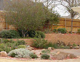 Custom Landscape Retaining Walls | Railroad Tie | Natural Stone