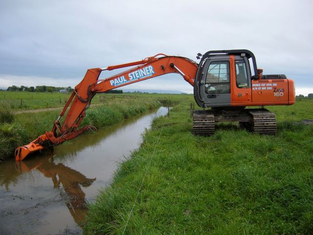 Machine digging a ditch as part as earthmoving services in Hamilton