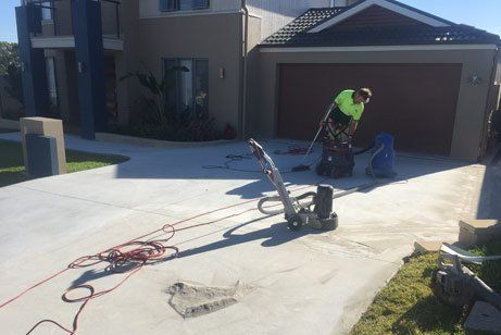 t and t coastal concreting working cleaning concrete