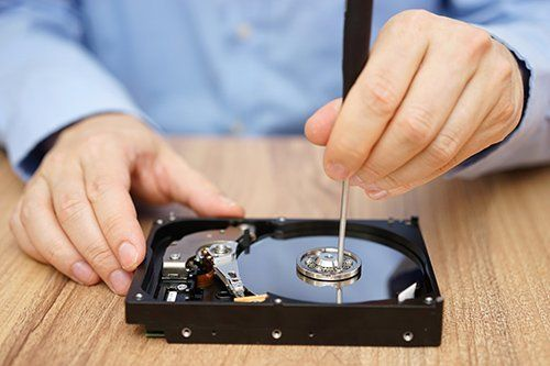 Hard disk being repaired by a Killa-Byte technician