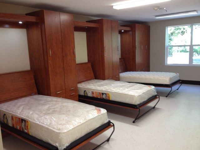 multiple murphy beds in a fire station