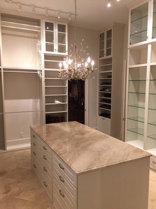 custom-closet-with-chandelier-and-island