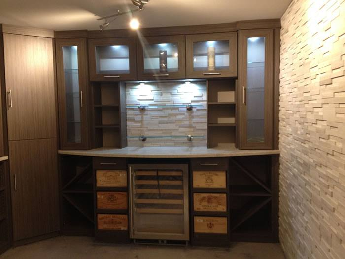 custom wine storage with L.E.D. lighting, shelves, and drawers