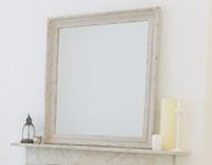 Mirror on fireplace
