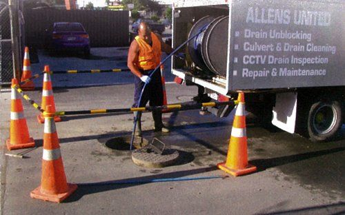 Professional providing septic tank services