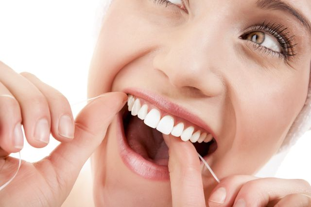 Woman Flossing Teeth, Dental Care in Naples NY