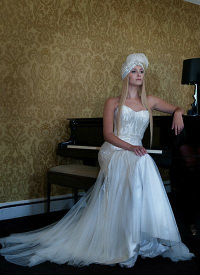 bride sitting by the piano