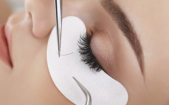 the makeup mirror specialist working on eyelash extension