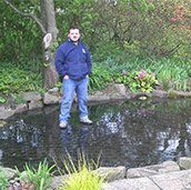 man standing in a pond