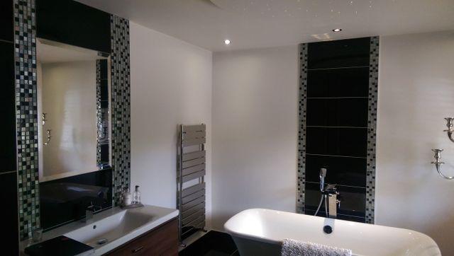 modern white handbasin against dark grey tiling