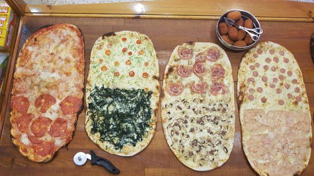 pizza condita con vari gusti