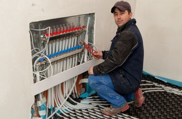 heating and cooling expert working on furnace repair in Eagle Bay, NY