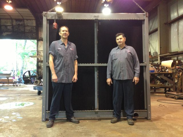 Two members of the team showing a radiator in St. Louis MO