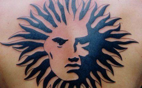 sun faced tattoo design