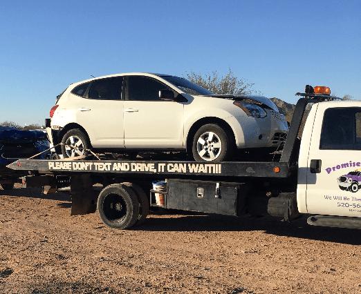 Man towing damaged car away