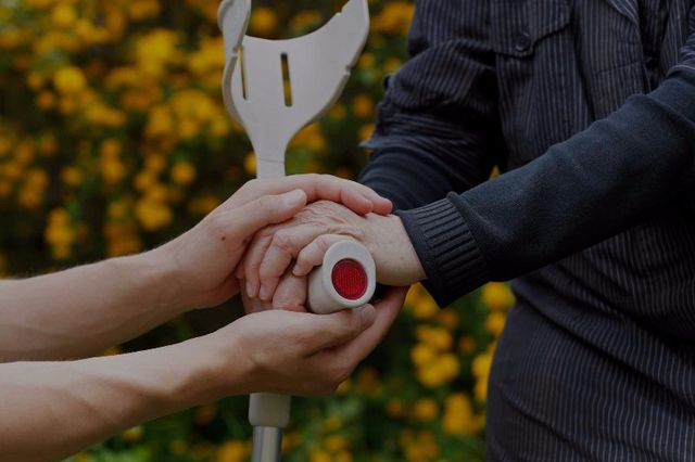 Attorney holding hands of a disabled person