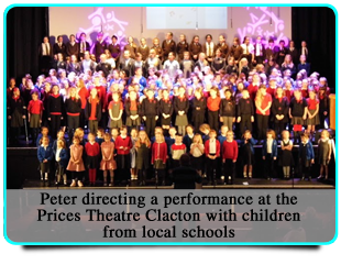 Peter directing a performance at the Prices Theatre Clacton with children from local schools