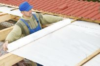 man working on roof during remodeling services in Wisconsin Rapids, WI