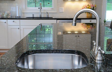 Modern stainless steel faucet and sink on kitchen