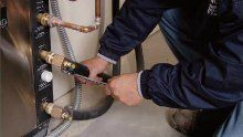 One of our plumbers making repairs at a home in Lincoln NE