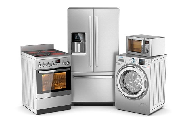 stainless steel kitchen appliances oven fridge washer and microwave