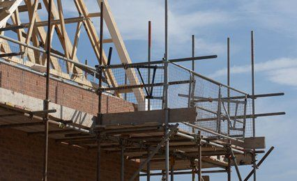 Scaffolding around the roof of a house
