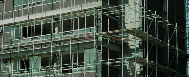 Caffolding platforms around a large building
