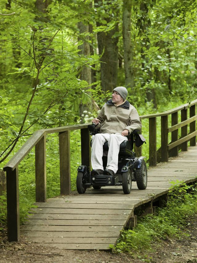 individual on wooden deck on wheelchair