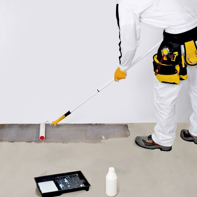 Polyurethane being applied to a concrete floor