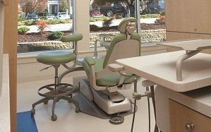 Child dental specialist dentist with young boy providing caring services in Highpoint, NC