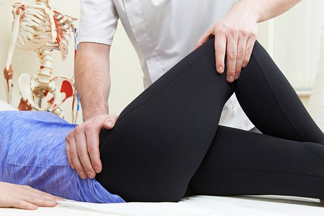 Patient receiving osteo leg massage and treatment
