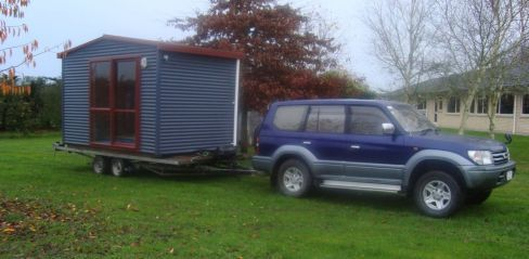 Contractor supervising installation of portable cabins in Waikato