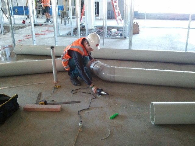 Team member installing fume extraction products in Auckland