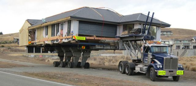 Our South Island team performing house removals and lifting