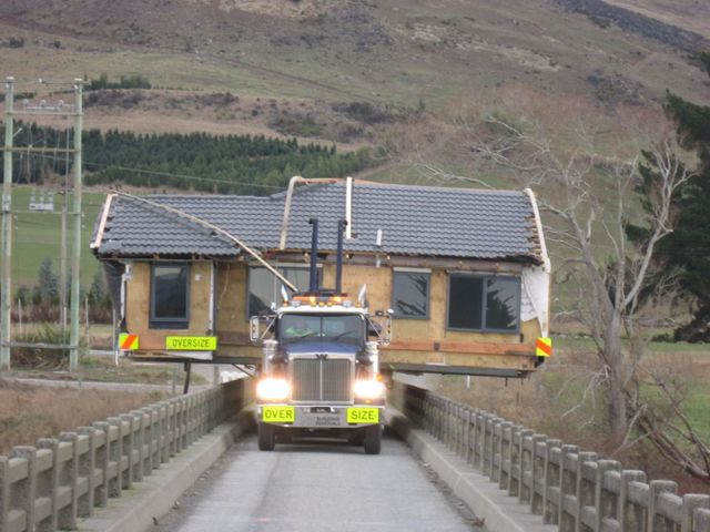 A house being driven down the road