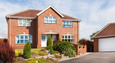 detached house with drive and separate garage