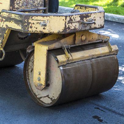 Heavy equipment rolling asphalt photo