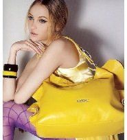girl sitting with handbag