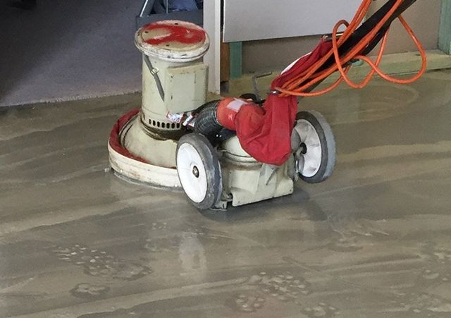 floor stripping machine at work