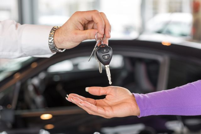 man gives woman keys to new car in Loveland, OH