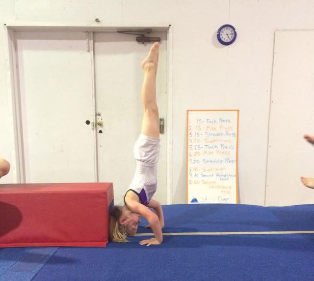 girl doing a head stand