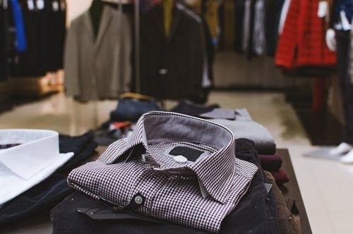 view of men's shirt, jeans and other clothes
