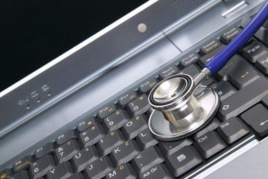 Abstract image of a laptop repair with stethoscope