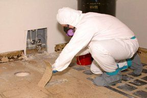 Careful asbestos removal on a vinyal surface