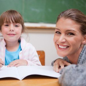 Teacher and child smiling